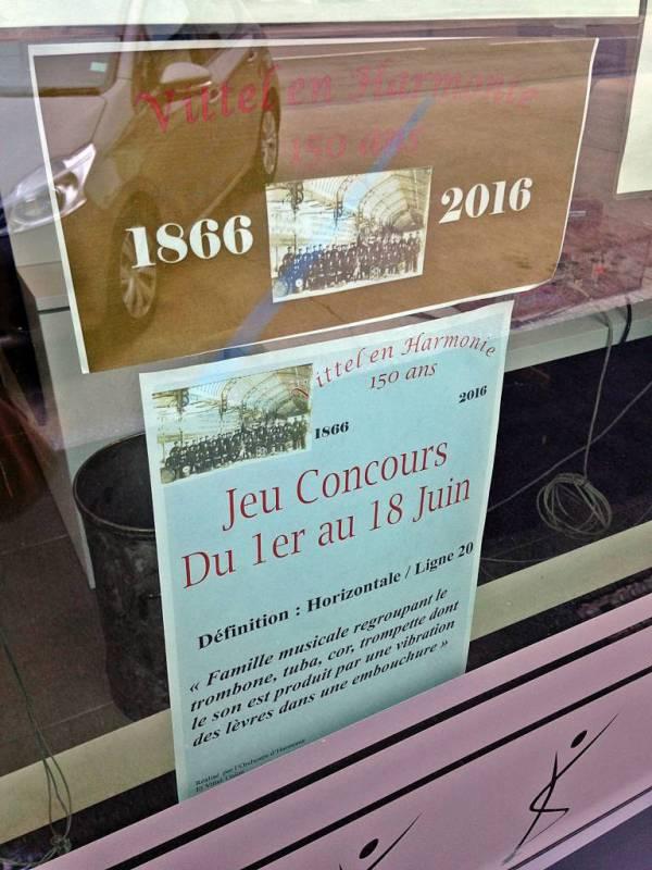 Affiche exposée dans les magasins participants.